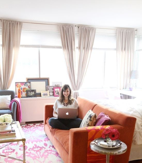 love that rug!!...@Nikki Rappaport Home Tour // orange couch // studio apartment layout // beige walls // colorful accents // pho...