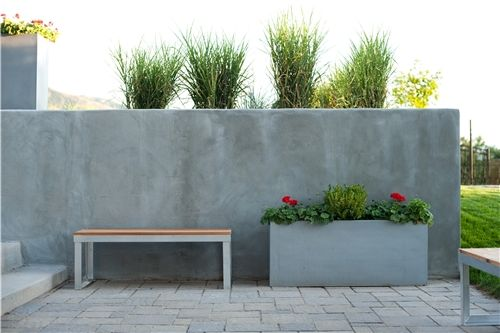 A simple concrete retaining wall, can be stained any colour, or even patterned.
