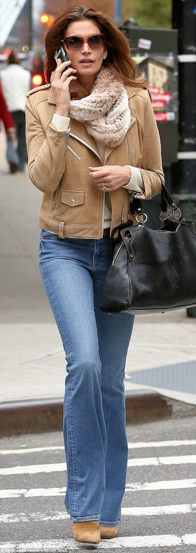 Classic look: Cindy Crawford wears boot cut jeans like a pro...