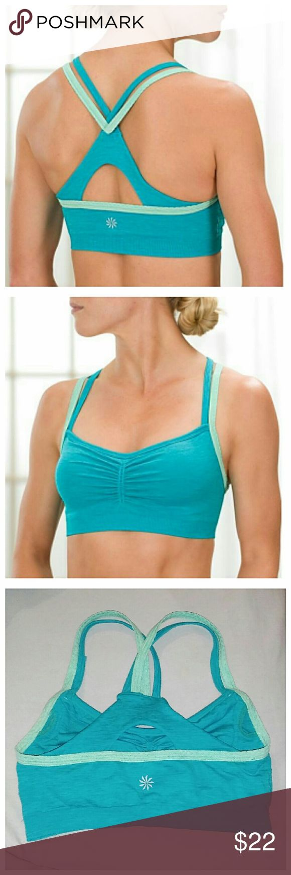 "Strappy Athleta Sports Bra Bold teal against baby blue makes this bra really pop. Alone or layered, it willl be the star of any outfit. Tho it does not come with cups, there is an opening for them. Band stretches from 22""- 28"". Athleta Intimates & Sleepwear Bras"