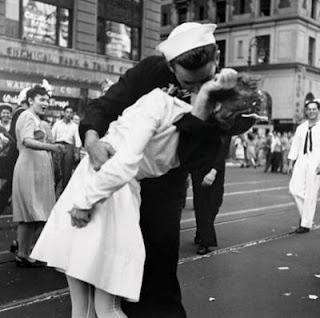 These two sweethearts are kissing the war goodbye as they embrace for the first time since the sailor left for battle. In stunning sepia photography this image truly is heart warming, capturing raw emotion and passion in a single shot.