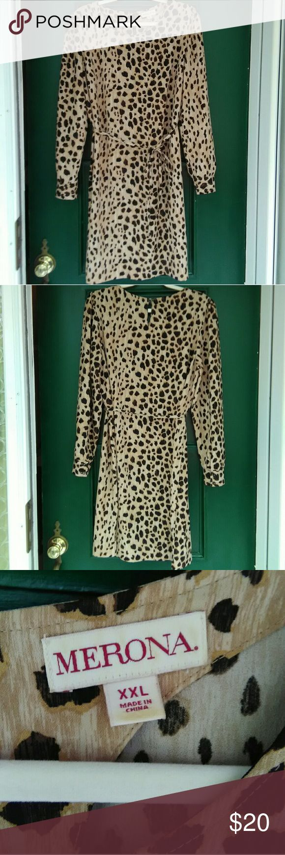 Animal Print Long Sleeve Dress This dress looked amazing on when I used to fit into it. It does stretch so don't let the pencil shape fool you. If you have some curves it looks amazing! The sleeves are cuffed with pretty buttons and the upper sleeve is a princess cut. This is a stunning dress. Merona Dresses Long Sleeve