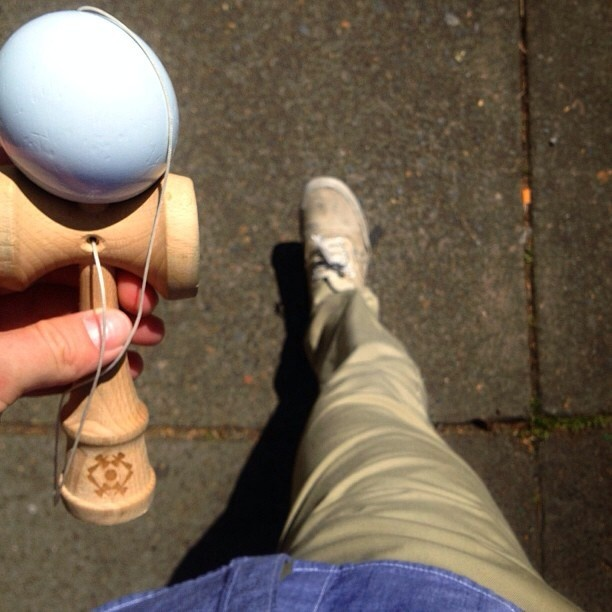 White Kendama toy by Tribute. Photo by @aaron_dav1s