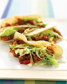 These soft tacos use lean ground sirloin and low-fat corn tortillas as sensible substitutions. Skip the sour cream and guacamole -- opt for a fiery salsa instead.