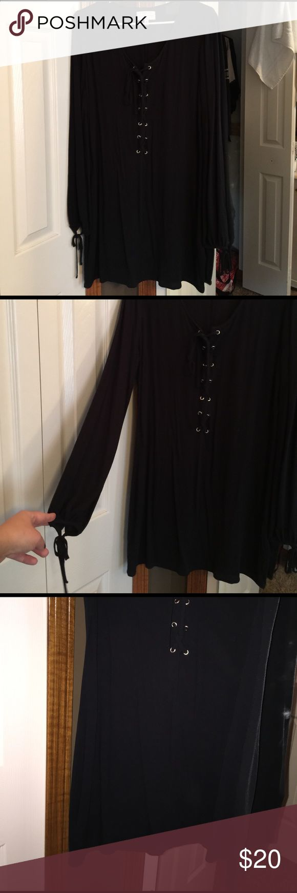 Kendall and Kylie dress Brand new!!!!! Flowy fit, ties down the front and crosses and ties at the wrists. Looks super cute with booties. Kendall & Kylie Dresses Long Sleeve