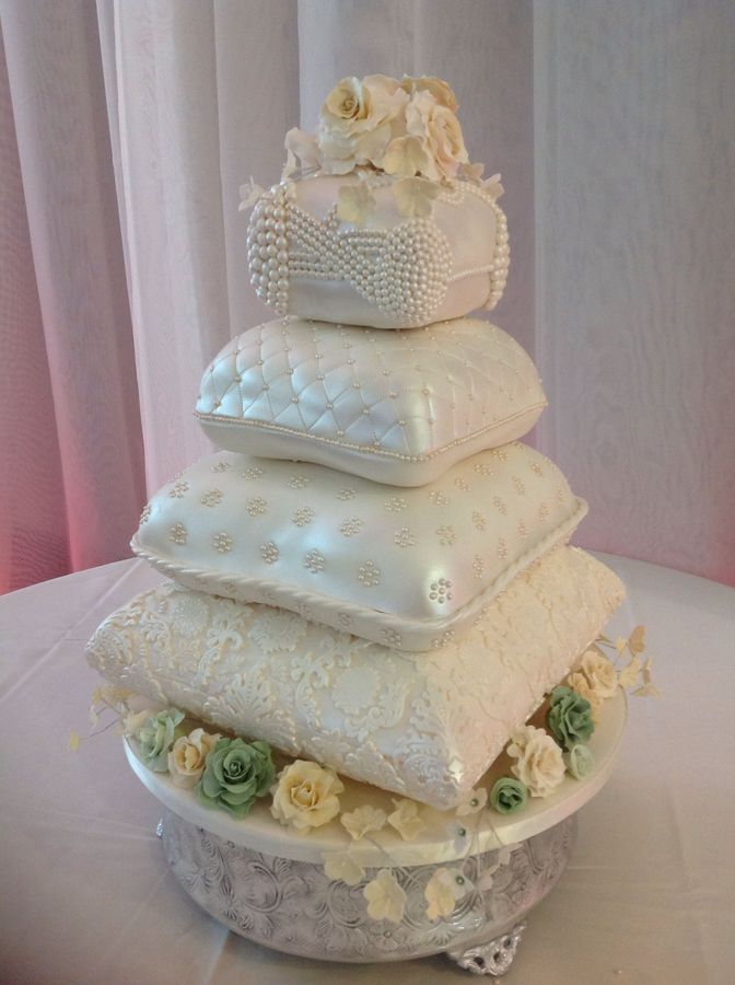 Gorgeous!  Pillow #weddingcake with over two thousand hand placed #pearls and handmade sugar flowers. ~ Gorgeous and all edible!!!
