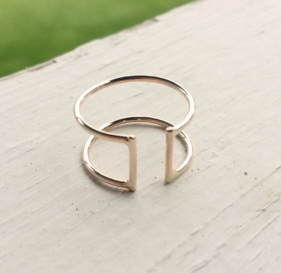 Sleek and modern sterling silver open double parallel bar ring. This simple, minimal, and modern ring is handcrafted in sections. Two parallel