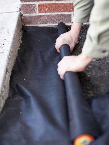 Weed Control  Lay landscape fabric over the bed, cutting edges so the fabric fits in place. The porous material allows water to flow through but blocks weeds from sprouting.