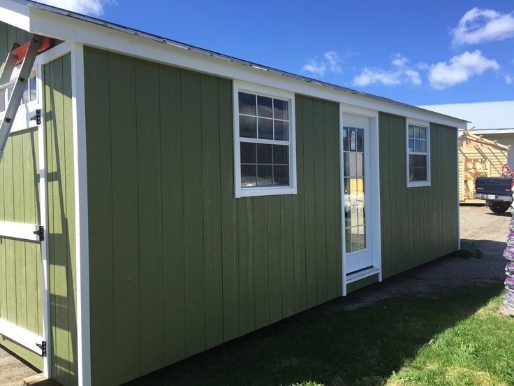 Here is a 12 x 24 shed that aesthetically is appealing for any property. It comes with double barn doors, a single door walk in and windows front and side to bring in the natural light. The building is made with L.P. Smartside siding that can be painted to any color.