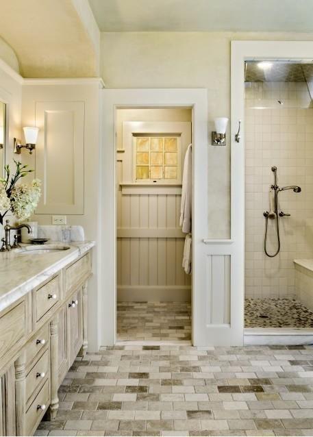 Window in bathroom beautifully designed master bathroom in neutral tones  (via Touch of Elegance Interiors onFacebook)