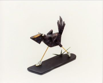 A small roadrunner in wood I made in the early 1990s.  Note his shoes.