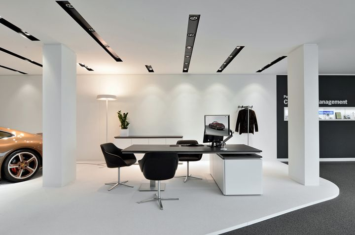 Porsche showroom by the store designers store design pinterest retail cars and ux ui for Modern showroom exterior design
