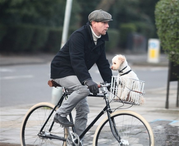 Could anything be cuter than a well-dressed Ewan McGregor biking with an adorable little poodle in his basket? We think not.