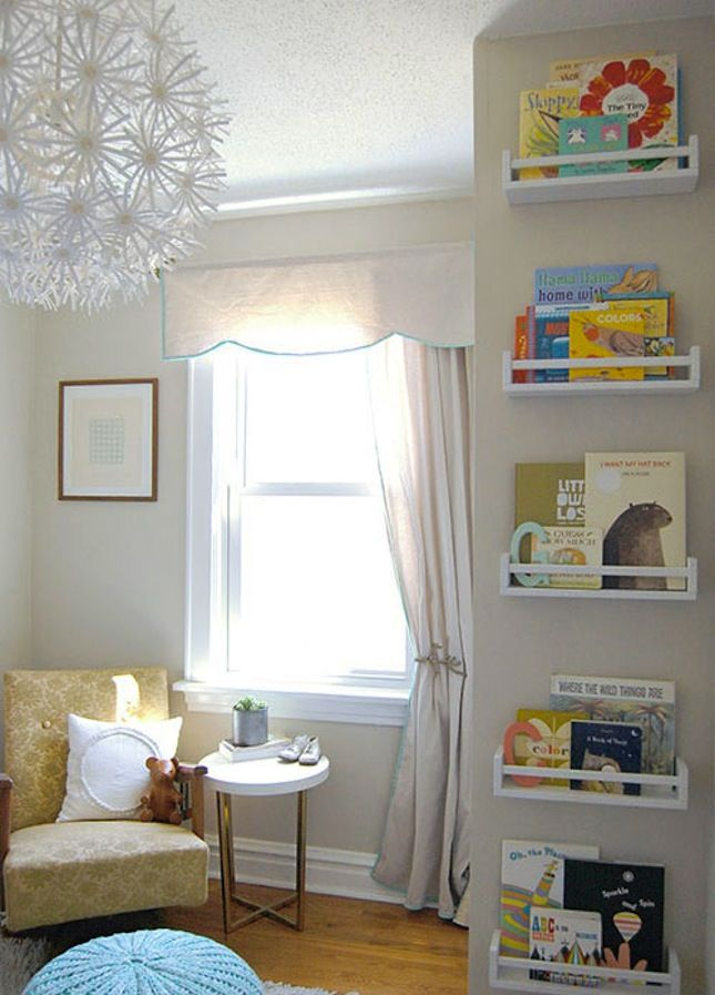 If there isn't room for a bookshelf, hang magazine racks on the wall for book storage. This vertical book shelf also doubles as wall art, because kids' books have the prettiest covers. (via Joy Ever After)