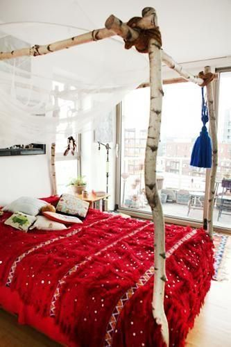 I really like the bed in this picture those branches would be even better with colourful silks and drapes on them...