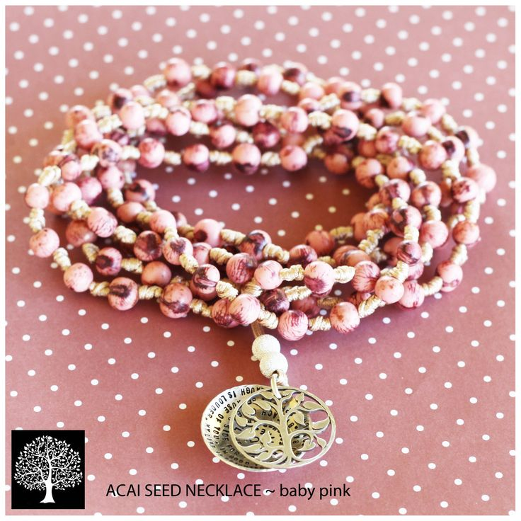 Knotted baby pink seed necklace with tree of life cupped pendant