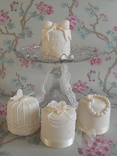 Mini cakes that are soooo pretty for a shower.  Love the white on white!