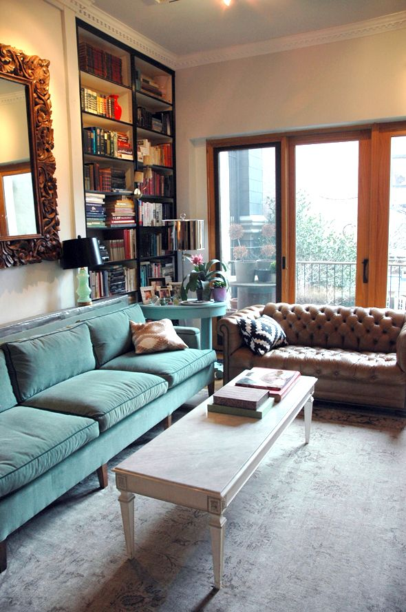 Little Green Notebook | Living Room with teal velvet sofa and gorgeous faded rug