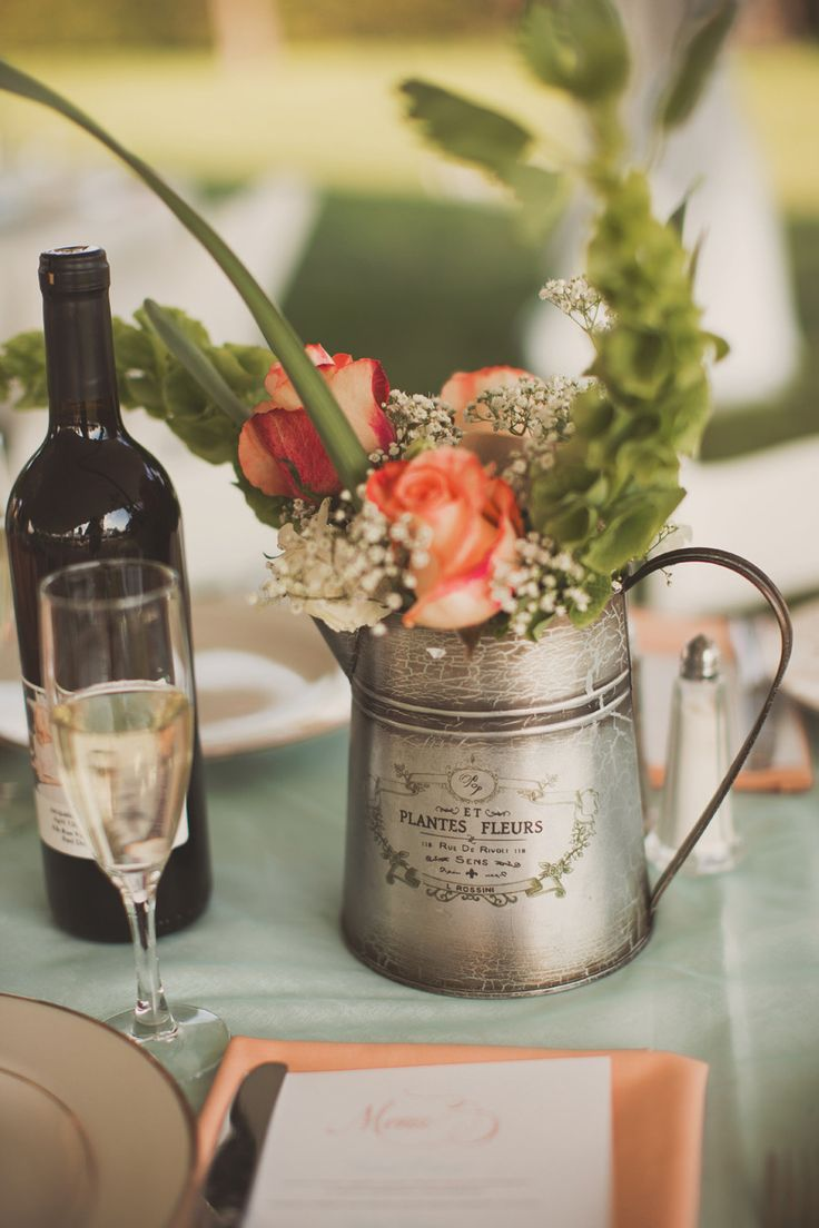 Metal pitcher flower centerpiece | Photography: Nessa K Photography - nessakblog.com  Read More: http://www.stylemepretty.com/2014/05/30/romantic-woodlawn-bed-breakfast-wedding/