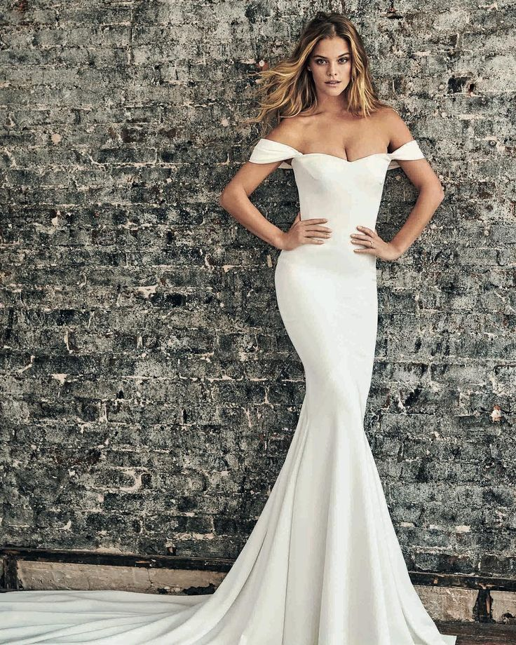"Pronovias on Instagram: ""Still in love with our recent shoot with the beautiful @ninaagdal in NYC. Especially her in our off-the-shoulder Raciela dress, made out of…"""