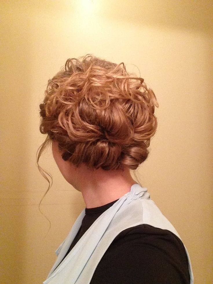 Pentecostal easy curly updo.  Great style for long to super long hair.