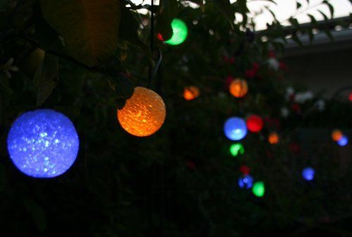 """Britta Products SSR-03 Luminous Glow Colored Solar String Light, Set of 21 by Britta Products. Save 16 Off!. $46.39. These unique and festive glowing spheres add warmth and atmosphere to any garden. Powered by a compact and powerful solar panel that can be ground mounted or attached to a nearby tree, post or building. Luminous Glow Colored Solar Strings add a festive colored glow to outdoor spaces; Includes 21 opaque weather-proof 2.5"""" balls and a solar panel kit. Beautifies your yard..."""
