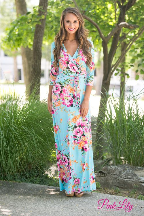 You will love wearing this comfortable and gorgeous floral maxi all summer long! Featuring floral print in shades of pink, green, orange, black, and white paired with a aqua fabric, it has the best colors of spring and summer rolled into one dress! It also has a matching fabric tie at waist, 3/4 sleeves, a v-neckline, and overlapping fabric on the bust for a fashionable wrap look.