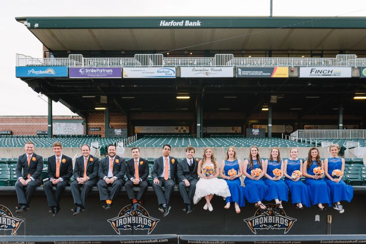 "Amanda and Tyler's wedding was rooted in love, faith, and baseball!  The ""flower-grandmas"" sprinkled the aisle with rose petals, and after they said ""i do"", they headed to Ripken Stadium in style for a super fun reception. Ripken Stadium 