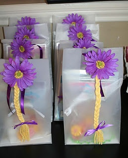 I made these Tangled Rapunzel hair clips to attach to the treat bags. The girls loved them!!