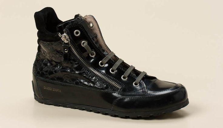 Auf den ersten Blick als Candice Cooper erkennbar ist dieser Sneaker high. Er besticht durch die Materialkombination aus schwarzem Velour-,  glanzgestoßenem und in Kroko-Optik bedrucktem Kalbleder.  Die Farbe der markanten, silberfarbenen Reißverschlüsse und Ösen wird durch die grauen Schnürsenkel aufgenommen. Durch seine Bequemlichkeit hat sich der sportliche Leisten mit der profilierten Gummisohle bewährt. Lassen Sie sich von dieser attraktiven Herbst-Variante überzeugen.