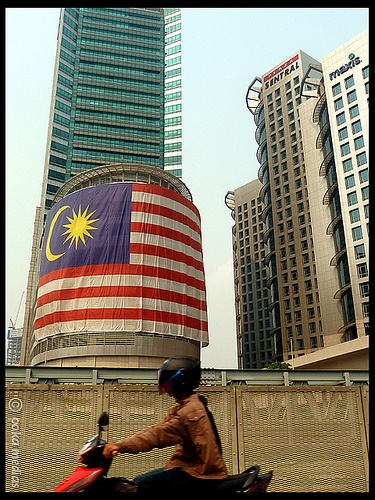 the flag of malaysia in the centre of the city