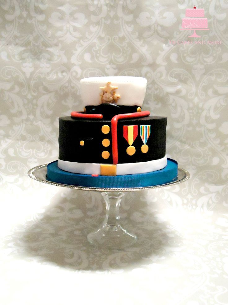 This cake is a US Marine Corps Dress Blue Uniform design. It is all buttercream with fondant appliques and a styro foam topper.
