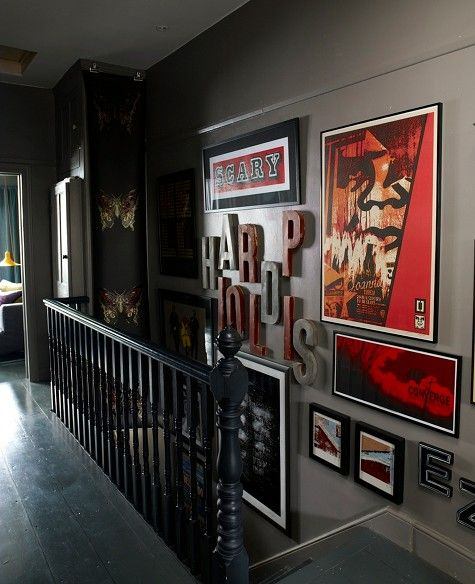 dark stairs/grey walls/gallery with one unifying colour