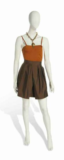 Quantum of Solace - A leotard and skirt ensemble designed by Jasper Conran and a necklace, worn by Olga Kurylenko as Camille Montes in Quantum Of Solace