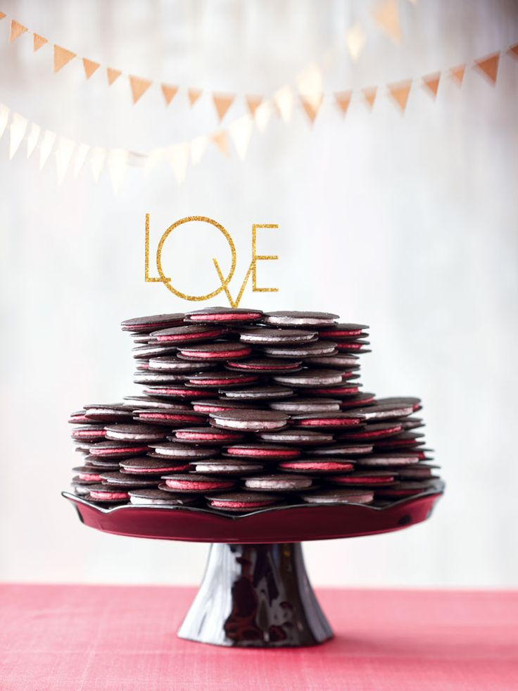 250 homemade chocolate wafers sandwiched with dark pink and light pink buttercream frosting, which were then stacked to make this modern wedding cake | Wedding Cakes To Suit Every Theme | Weddingbells