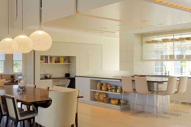 12 All White Interiors that Deliver a Fresh Look Posted July 04, 2014 designed by Workshop/apd I like the open feel of the cabinetry and the sleek surface of the bar/island.  This is an interesting and eclectic blend of design styles --- reminds me of some scandinavian interiors.