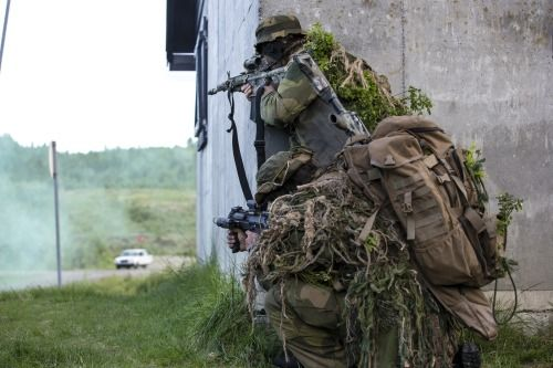 A Norwegian sniper team with the reconnaissance squadron, Telemark battalion, during a training mission in an urban environment. June 5, 2012.