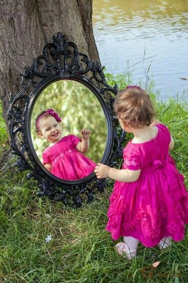 Infant staring into mirror