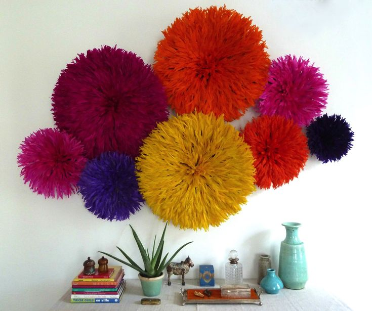 Not one Juju. Many Juju!  Kronbali: Bright color Juju hat wall installation