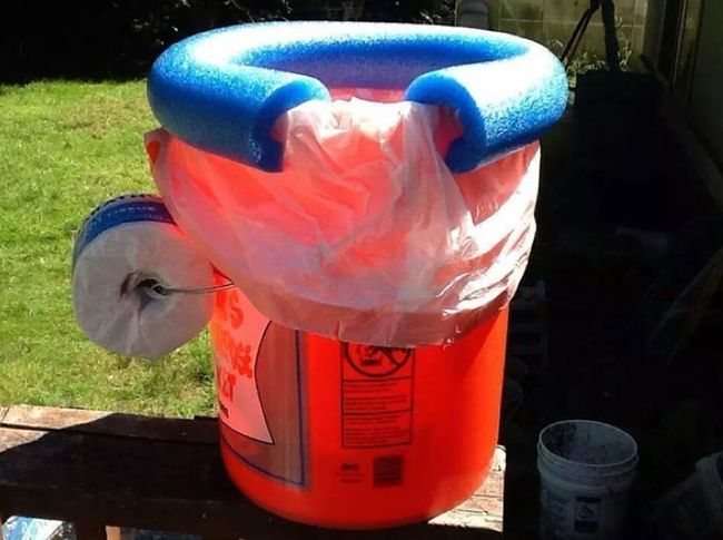 22.) Bucket Toilet With Pool Noodle Seat