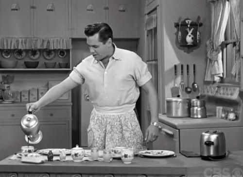 Desi Arnaz // I love Lucy-- a man in the kitchen...in the 50's...had to wear an apron.