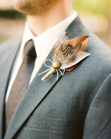 This boutonniere was made from tweed, burlap, canvas remnants, twine, feathers, and antique buttons