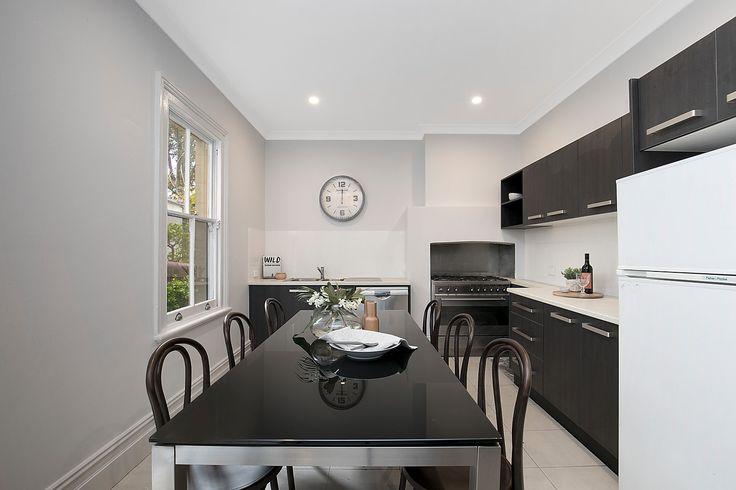 Large eat-in kitchen opens to side c'yard Smeg 6-burner gas range, Bosch dishwasher