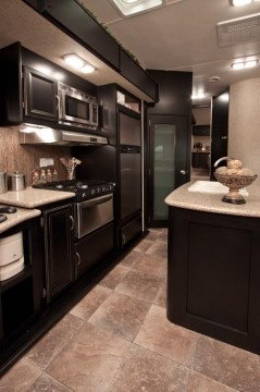 Love this black kitchen with stainless! < Heartland Toy Haulers   Heartland RVs