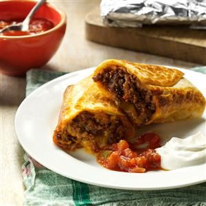 Tasty Burritos Recipe- Recipes  My cousin is of Mexican heritage, and I've watched her make these crunchy burritos for years. The very first time I made them for my own family, they became an instant favorite meal. They're even better warmed up the next day in the microwave. —Debi Lane, Chattanooga, Tennessee