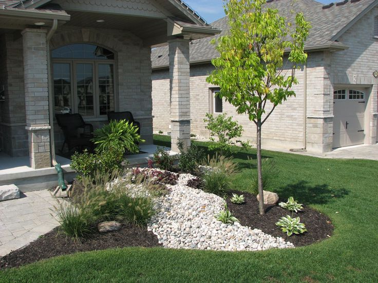 front garden idea to create visual interest use rocks dry river bed - Garden Ideas Ontario