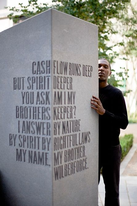 Lemn Sissay at the memorial to the abolition of the transatlantic slave trade in the City of London, which features words from his poem The Gilt of Cain.