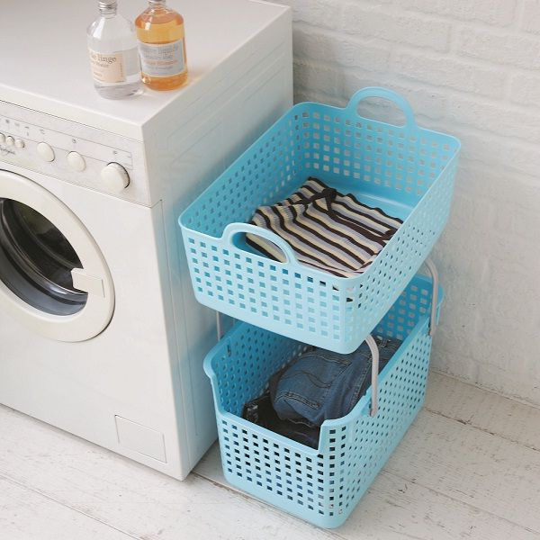 Two-level stackable laundry baskets to easily separate light and dark-colored clothes.