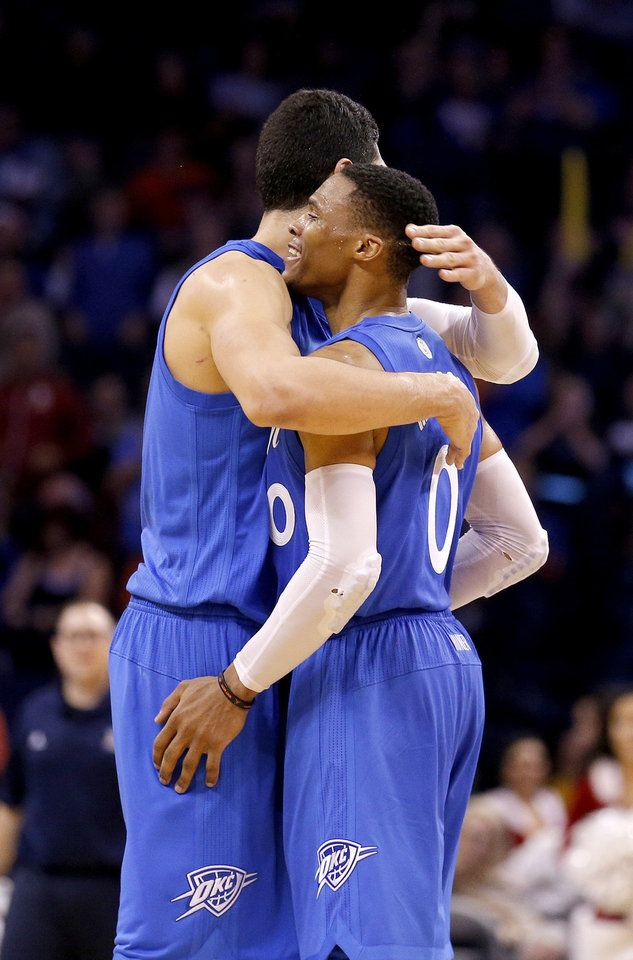 Oklahoma City's Enes Kanter (11) and Russell Westbrook (0) celebrate a Thunder basket during the NBA game between the Oklahoma City Thunder and the Minnesota Timberwolves at the Chesapeake Energy Arena,  Sunday, Dec. 25, 2016. Photo by Sarah Phipps, The Oklahoman