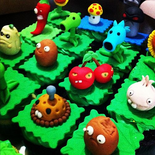 Plants vs. Zombies Cupcakes!  Absolutely terrific.  I can play this game for hours and the Zombies always stress me out.